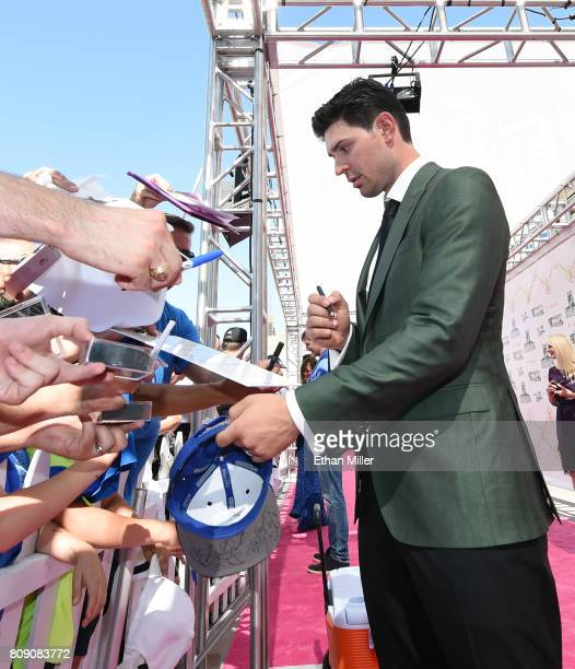 Carey Price of the Montreal Canadiens signs autographs for fans as he attends the 2017 NHL Awards at TMobile Arena on June 21 2017 in Las Vegas Nevada