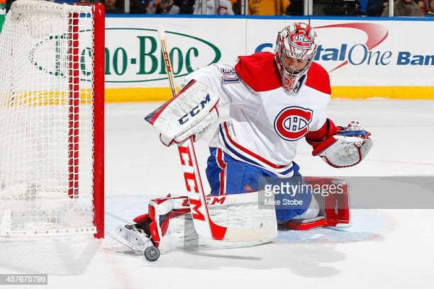 Carey Price of the Montreal Canadiens skates against the New York Islanders at Nassau Veterans Memorial Coliseum on December 14 2013 in Uniondale New...