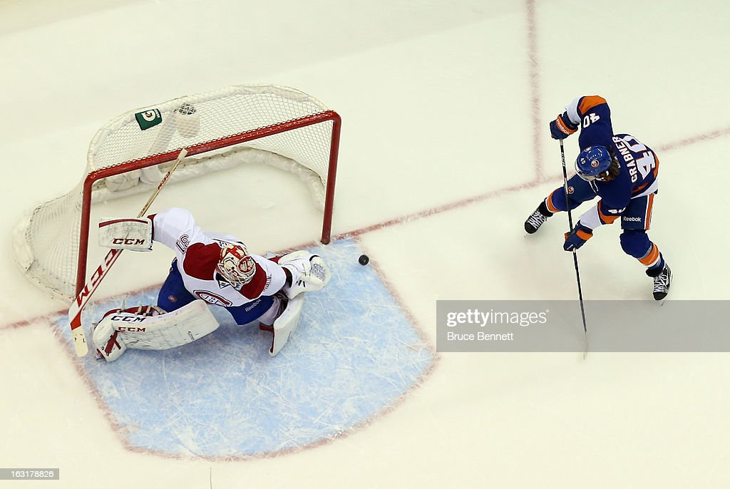 Carey Price #31 of the Montreal Canadiens slides across to make the save on Michael Grabner #40 of the New York Islanders at the Nassau Veterans Memorial Coliseum on March 5, 2013 in Uniondale, New York. The Islanders defeated the Canadiens 6-3.