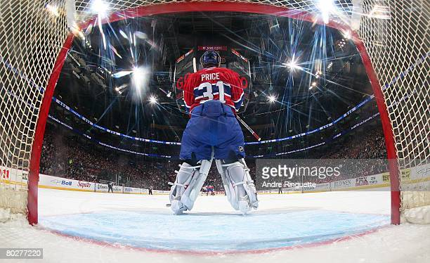 Carey Price of the Montreal Canadiens stands in his crease and looks up ice against the Ottawa Senators at the Bell Centre on March 13 2008 in...
