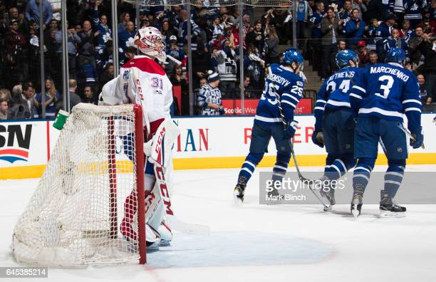 Carey Price of the Montreal Canadiens stands in his net after giving up a goal to Auston Matthews of the Toronto Maple Leafs who skates away with...
