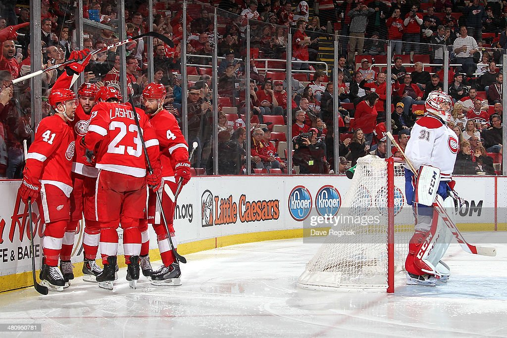 <a gi-track='captionPersonalityLinkClicked' href=/galleries/search?phrase=Carey+Price&family=editorial&specificpeople=2222083 ng-click='$event.stopPropagation()'>Carey Price</a> #31 of the Montreal Canadiens stands in the crease as <a gi-track='captionPersonalityLinkClicked' href=/galleries/search?phrase=Luke+Glendening&family=editorial&specificpeople=5650380 ng-click='$event.stopPropagation()'>Luke Glendening</a> #41, <a gi-track='captionPersonalityLinkClicked' href=/galleries/search?phrase=Brian+Lashoff&family=editorial&specificpeople=5529056 ng-click='$event.stopPropagation()'>Brian Lashoff</a> #23, <a gi-track='captionPersonalityLinkClicked' href=/galleries/search?phrase=Jakub+Kindl&family=editorial&specificpeople=716743 ng-click='$event.stopPropagation()'>Jakub Kindl</a> #4 and Tomas Jurco #26 of the Detroit Red Wings congratulate teammate <a gi-track='captionPersonalityLinkClicked' href=/galleries/search?phrase=Riley+Sheahan&family=editorial&specificpeople=7029365 ng-click='$event.stopPropagation()'>Riley Sheahan</a> #15 after scoring a goal during an NHL game on March 27, 2014 at Joe Louis Arena in Detroit, Michigan.