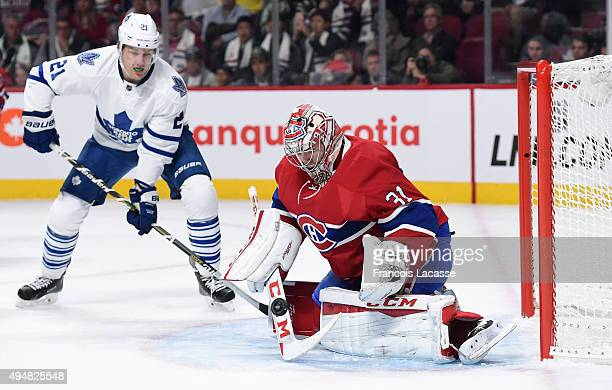 Carey Price of the Montreal Canadiens stops a shot by the Toronto Maple Leafs in the NHL game at the Bell Centre on October 24 2015 in Montreal...