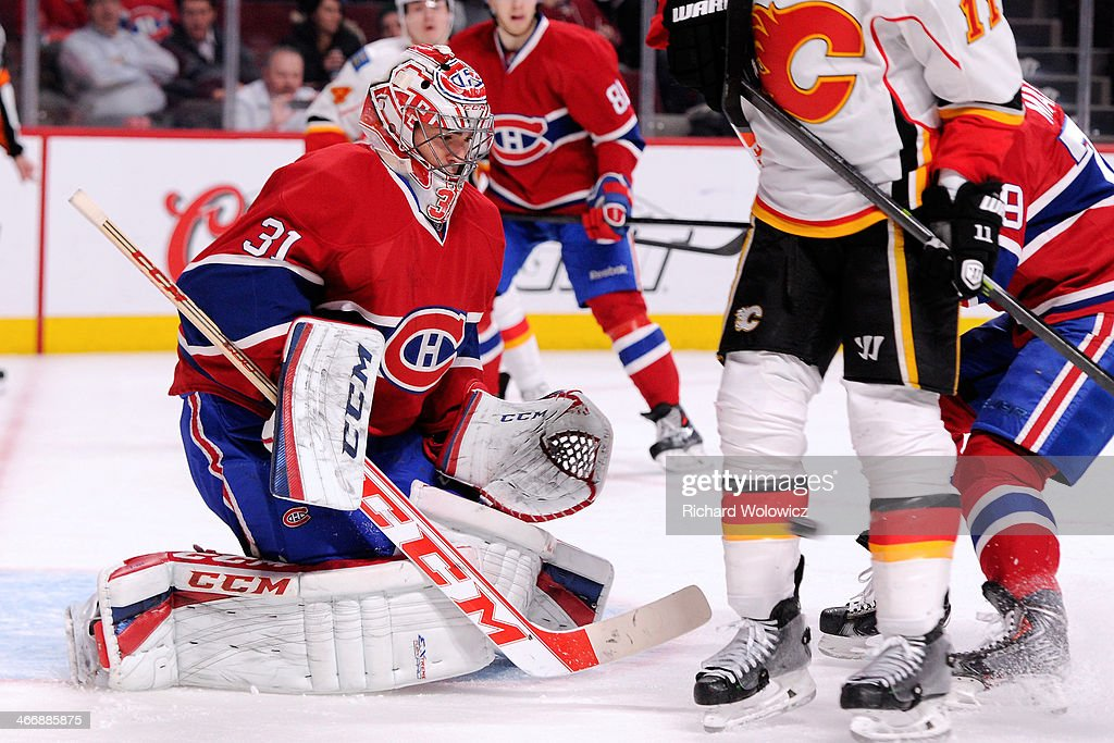 <a gi-track='captionPersonalityLinkClicked' href=/galleries/search?phrase=Carey+Price&family=editorial&specificpeople=2222083 ng-click='$event.stopPropagation()'>Carey Price</a> #31 of the Montreal Canadiens stops the puck against the Calgary Flames during the NHL game at the Bell Centre on February 4, 2014 in Montreal, Quebec, Canada. The Canadiens defeated the Flames 2-0.