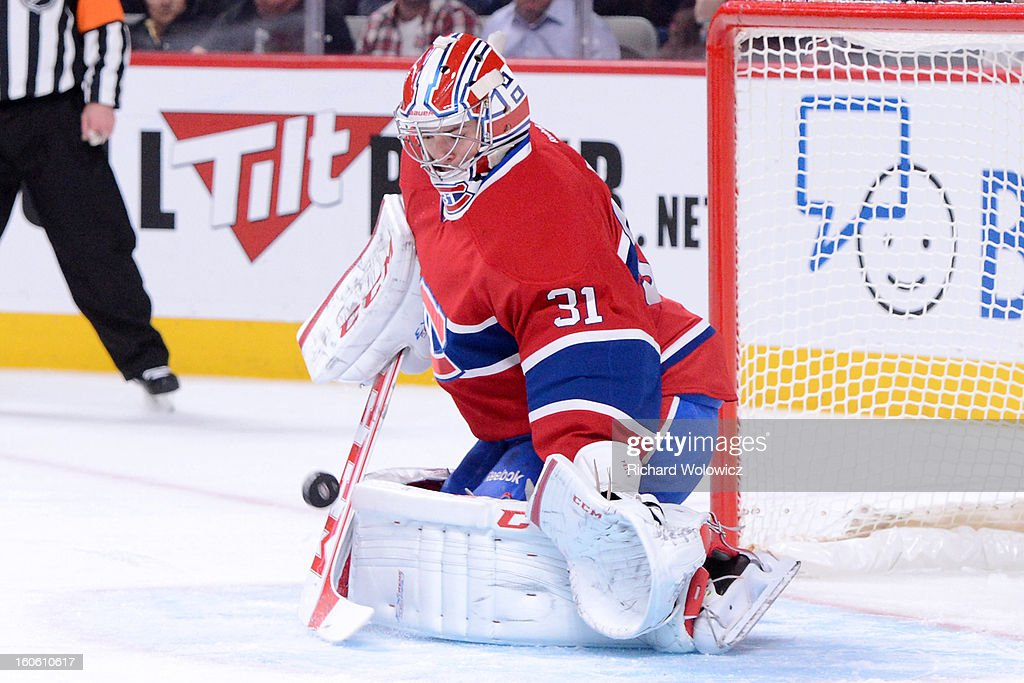 <a gi-track='captionPersonalityLinkClicked' href=/galleries/search?phrase=Carey+Price&family=editorial&specificpeople=2222083 ng-click='$event.stopPropagation()'>Carey Price</a> #31 of the Montreal Canadiens stops the puck during the NHL game against the Ottawa Senators at the Bell Centre on February 3, 2013 in Montreal, Quebec, Canada. The Canadiens defeated the Senators 2-1.