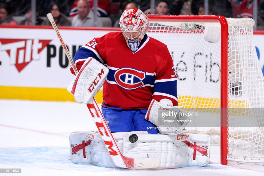 <a gi-track='captionPersonalityLinkClicked' href=/galleries/search?phrase=Carey+Price&family=editorial&specificpeople=2222083 ng-click='$event.stopPropagation()'>Carey Price</a> #31 of the Montreal Canadiens stops the puck during the NHL game against the New York Rangers at the Bell Centre on March 30, 2013 in Montreal, Quebec, Canada. The Canadiens defeated the Rangers 3-0.