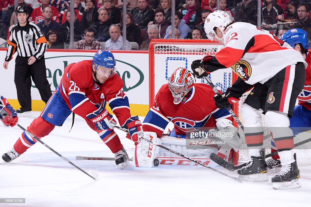 <a gi-track='captionPersonalityLinkClicked' href=/galleries/search?phrase=Carey+Price&family=editorial&specificpeople=2222083 ng-click='$event.stopPropagation()'>Carey Price</a> #31 of the Montreal Canadiens stops the puck in front of <a gi-track='captionPersonalityLinkClicked' href=/galleries/search?phrase=Erik+Condra&family=editorial&specificpeople=6254234 ng-click='$event.stopPropagation()'>Erik Condra</a> #22 of the Ottawa Senators during the NHL game at the Bell Centre on February 3, 2013 in Montreal, Quebec, Canada. The Canadiens defeated the Senators 2-1.