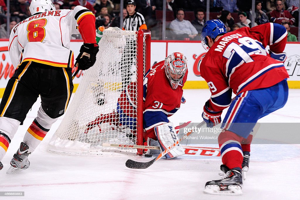 <a gi-track='captionPersonalityLinkClicked' href=/galleries/search?phrase=Carey+Price&family=editorial&specificpeople=2222083 ng-click='$event.stopPropagation()'>Carey Price</a> #31 of the Montreal Canadiens stops the puck in front of <a gi-track='captionPersonalityLinkClicked' href=/galleries/search?phrase=Joe+Colborne&family=editorial&specificpeople=5370968 ng-click='$event.stopPropagation()'>Joe Colborne</a> #8 of the Calgary Flames during the NHL game at the Bell Centre on February 4, 2014 in Montreal, Quebec, Canada. The Canadiens defeated the Flames 2-0.