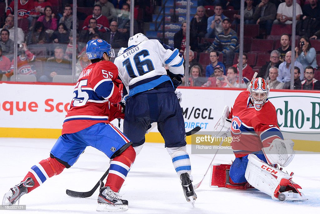 <a gi-track='captionPersonalityLinkClicked' href=/galleries/search?phrase=Carey+Price&family=editorial&specificpeople=2222083 ng-click='$event.stopPropagation()'>Carey Price</a> #31 of the Montreal Canadiens stops the puck in front of <a gi-track='captionPersonalityLinkClicked' href=/galleries/search?phrase=Andrew+Ladd&family=editorial&specificpeople=228452 ng-click='$event.stopPropagation()'>Andrew Ladd</a> #16 of the Winnipeg Jets during the NHL game at the Bell Centre on January 29, 2013 in Montreal, Quebec, Canada. The Canadiens defeated the Jets 4-3.