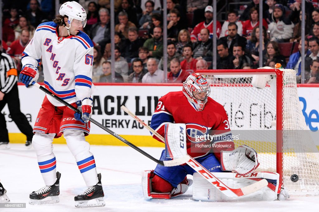 Carey Price #31 of the Montreal Canadiens stops the puck in front of Benoit Pouliot #67 of the New York Rangers during the NHL game at the Bell Centre on April 12, 2014 in Montreal, Quebec, Canada.