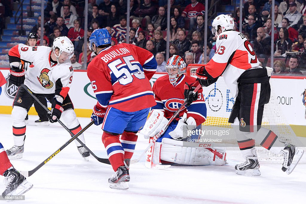 Carey Price #31 of the Montreal Canadiens stops the puck in front of Milan Michalek #9 and Mika Zibanejad #93 of the Ottawa Senators during the NHL game at the Bell Centre on February 3, 2013 in Montreal, Quebec, Canada. The Canadiens defeated the Senators 2-1.