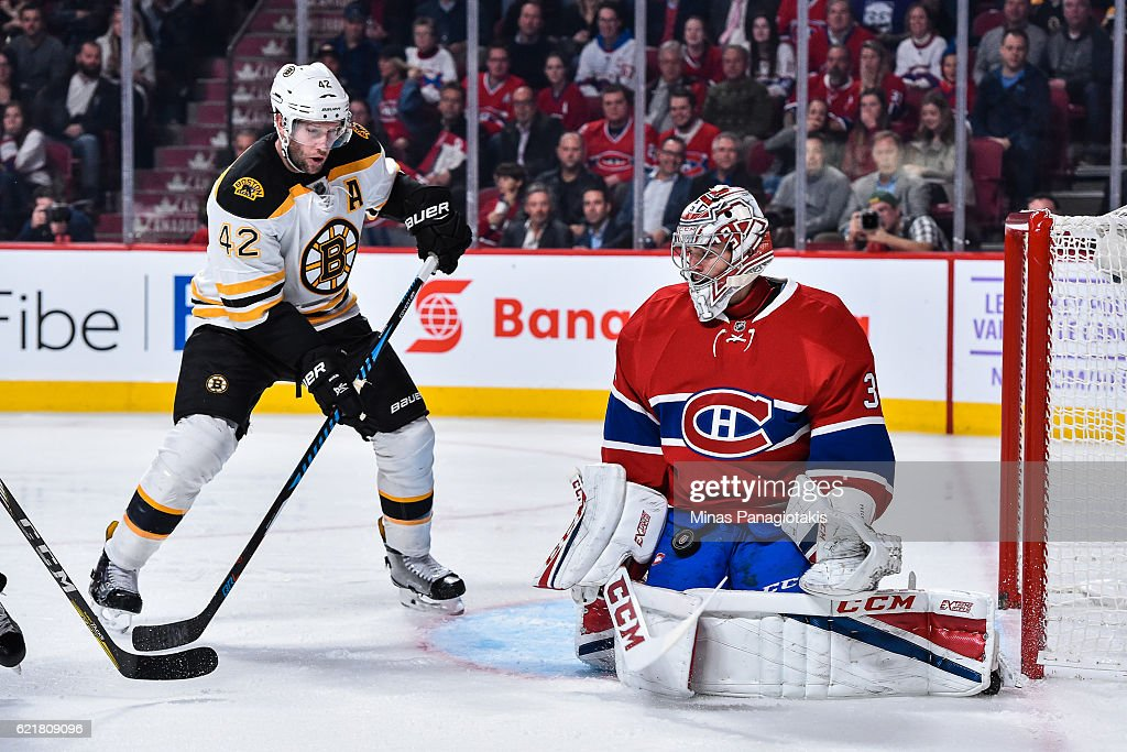 Carey Price #31 of the Montreal Canadiens stops the puck near David Backes #42 of the Boston Bruins during the NHL game at the Bell Centre on November 8, 2016 in Montreal, Quebec, Canada. The Montreal Canadiens defeated the Boston Bruins 3-2.