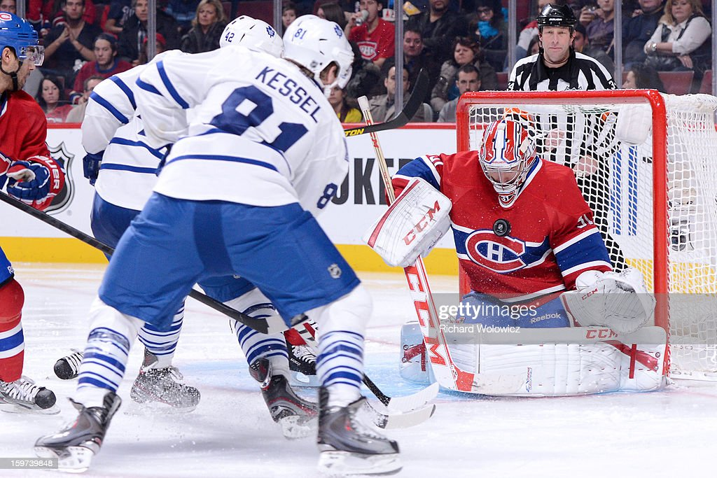 <a gi-track='captionPersonalityLinkClicked' href=/galleries/search?phrase=Carey+Price&family=editorial&specificpeople=2222083 ng-click='$event.stopPropagation()'>Carey Price</a> #31 of the Montreal Canadiens stops the puck on a shot by <a gi-track='captionPersonalityLinkClicked' href=/galleries/search?phrase=Phil+Kessel&family=editorial&specificpeople=537794 ng-click='$event.stopPropagation()'>Phil Kessel</a> #81 of the Toronto Maple Leafs during the NHL game at the Bell Centre on January 19, 2013 in Montreal, Quebec, Canada. The Maple Leafs defeated the Canadiens 2-1.