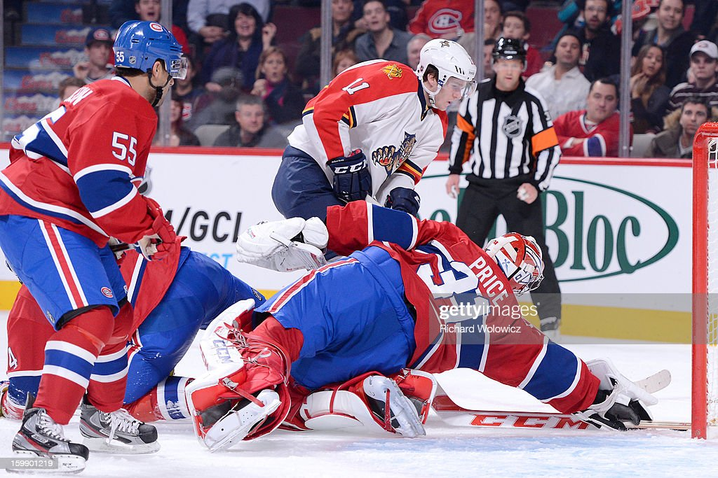 <a gi-track='captionPersonalityLinkClicked' href=/galleries/search?phrase=Carey+Price&family=editorial&specificpeople=2222083 ng-click='$event.stopPropagation()'>Carey Price</a> #31 of the Montreal Canadiens stops the puck on a shot by <a gi-track='captionPersonalityLinkClicked' href=/galleries/search?phrase=Jonathan+Huberdeau&family=editorial&specificpeople=7144196 ng-click='$event.stopPropagation()'>Jonathan Huberdeau</a> #11 of the Florida Panthers during the NHL game at the Bell Centre on January 22, 2013 in Montreal, Quebec, Canada. The Canadiens defeated the Panthers 4-1.