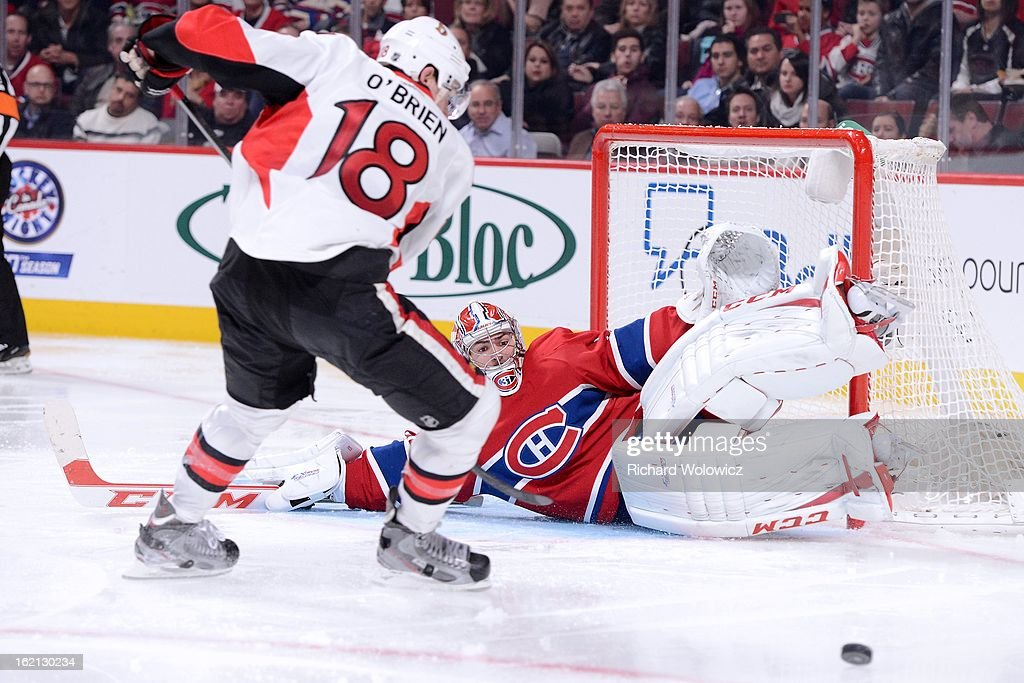 Carey Price #31 of the Montreal Canadiens stops the puck on an attempt by Jim O'Brien #18 of the Ottawa Senators during the NHL game at the Bell Centre on February 3, 2013 in Montreal, Quebec, Canada. The Canadiens defeated the Senators 2-1.