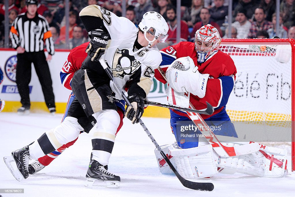 Carey Price #31 of the Montreal Canadiens stops the puck on an attempt by Sidney Crosby #87 of the Pittsburgh Penguins during the NHL game at the Bell Centre on March 2, 2013 in Montreal, Quebec, Canada.