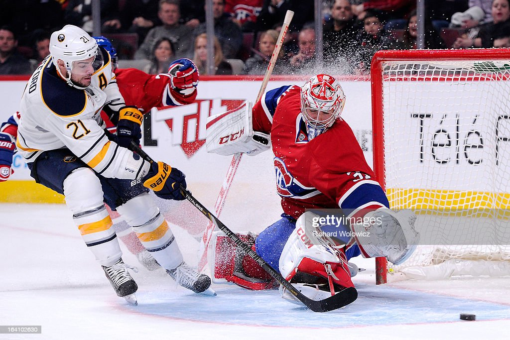 <a gi-track='captionPersonalityLinkClicked' href=/galleries/search?phrase=Carey+Price&family=editorial&specificpeople=2222083 ng-click='$event.stopPropagation()'>Carey Price</a> #31 of the Montreal Canadiens stops the puck on an attempt by <a gi-track='captionPersonalityLinkClicked' href=/galleries/search?phrase=Drew+Stafford&family=editorial&specificpeople=220617 ng-click='$event.stopPropagation()'>Drew Stafford</a> #21 of the Buffalo Sabres during the NHL game at the Bell Centre on March 19, 2013 in Montreal, Quebec, Canada. The Sabres defeated the Canadiens 3-2 in overtime.