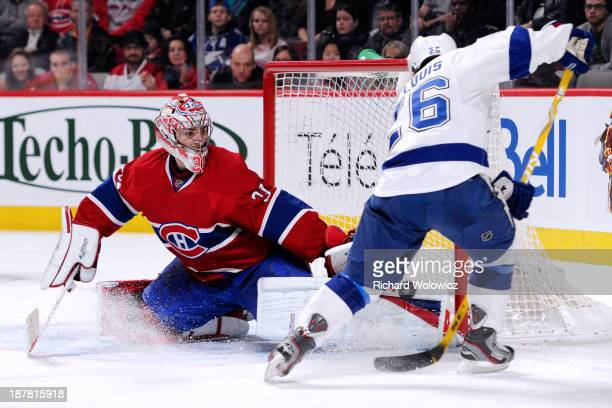 Carey Price of the Montreal Canadiens stops the puck on an attempt by Martin St Louis of the Tampa Bay Lightning during the NHL game at the Bell...