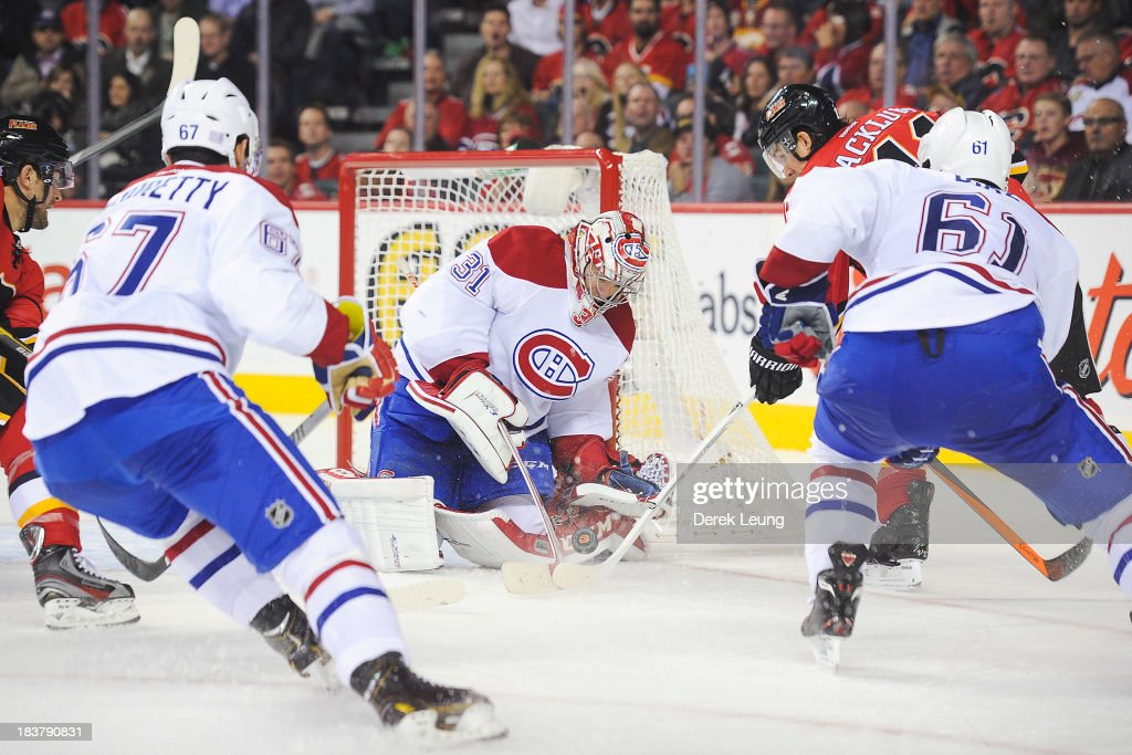 <a gi-track='captionPersonalityLinkClicked' href=/galleries/search?phrase=Carey+Price&family=editorial&specificpeople=2222083 ng-click='$event.stopPropagation()'>Carey Price</a> #31 of the Montreal Canadiens stops the shot of <a gi-track='captionPersonalityLinkClicked' href=/galleries/search?phrase=Mikael+Backlund&family=editorial&specificpeople=4324942 ng-click='$event.stopPropagation()'>Mikael Backlund</a> #11 of the Calgary Flames during an NHL game at Scotiabank Saddledome on October 9, 2013 in Calgary, Alberta, Canada. The Calgary Flames defeated the Montreal Canadiens 3-2.
