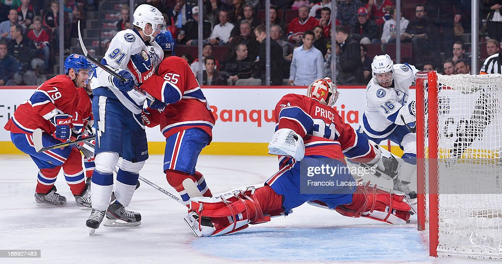 <a gi-track='captionPersonalityLinkClicked' href=/galleries/search?phrase=Carey+Price&family=editorial&specificpeople=2222083 ng-click='$event.stopPropagation()'>Carey Price</a> #31 of the Montreal Canadiens stretches to stop a shot by <a gi-track='captionPersonalityLinkClicked' href=/galleries/search?phrase=Teddy+Purcell&family=editorial&specificpeople=4537302 ng-click='$event.stopPropagation()'>Teddy Purcell</a> #16 of the Tampa Bay Lightning in NHL action on April 18, 2013 at the Bell Centre in Montreal, Quebec, Canada.