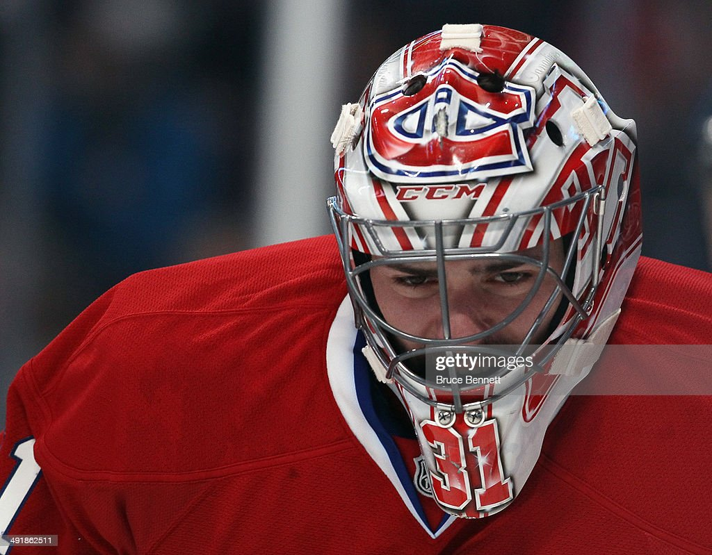 Carey Price #31 of the Montreal Canadiens takes a break during the game against the New York Rangers in Game One of the Eastern Conference Final during the 2014 Stanley Cup Playoffs at the Bell Centre on May 17, 2014 in Montreal, Canada. The Rangers defeated the Canadiens 7-2.