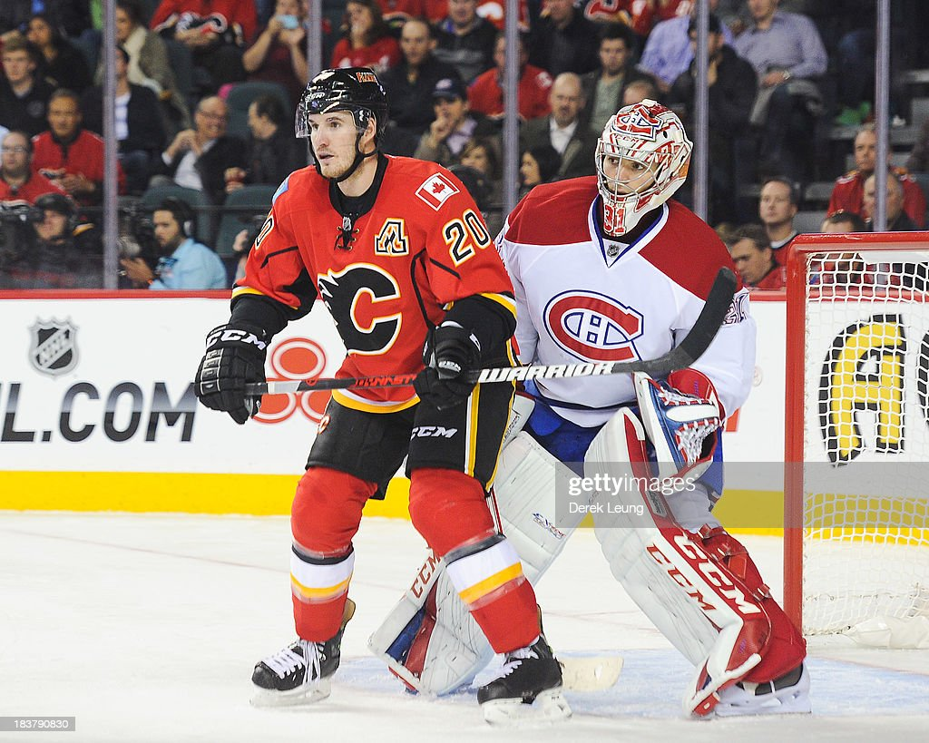 <a gi-track='captionPersonalityLinkClicked' href=/galleries/search?phrase=Carey+Price&family=editorial&specificpeople=2222083 ng-click='$event.stopPropagation()'>Carey Price</a> #31 of the Montreal Canadiens tries to see past the screen of <a gi-track='captionPersonalityLinkClicked' href=/galleries/search?phrase=Curtis+Glencross&family=editorial&specificpeople=2190970 ng-click='$event.stopPropagation()'>Curtis Glencross</a> #20 of the Calgary Flames during an NHL game at Scotiabank Saddledome on October 9, 2013 in Calgary, Alberta, Canada. The Calgary Flames defeated the Montreal Canadiens 3-2.