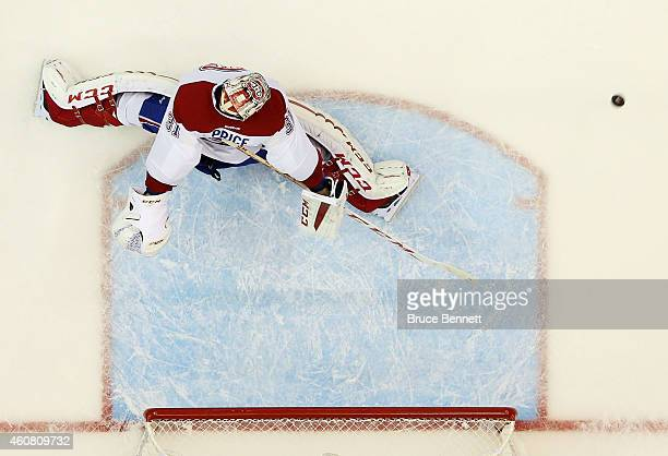 Carey Price of the Montreal Canadiens watches as a puck shot by Kyle Okposo of the New York Islanders flies past for a first period goal at Nassau...