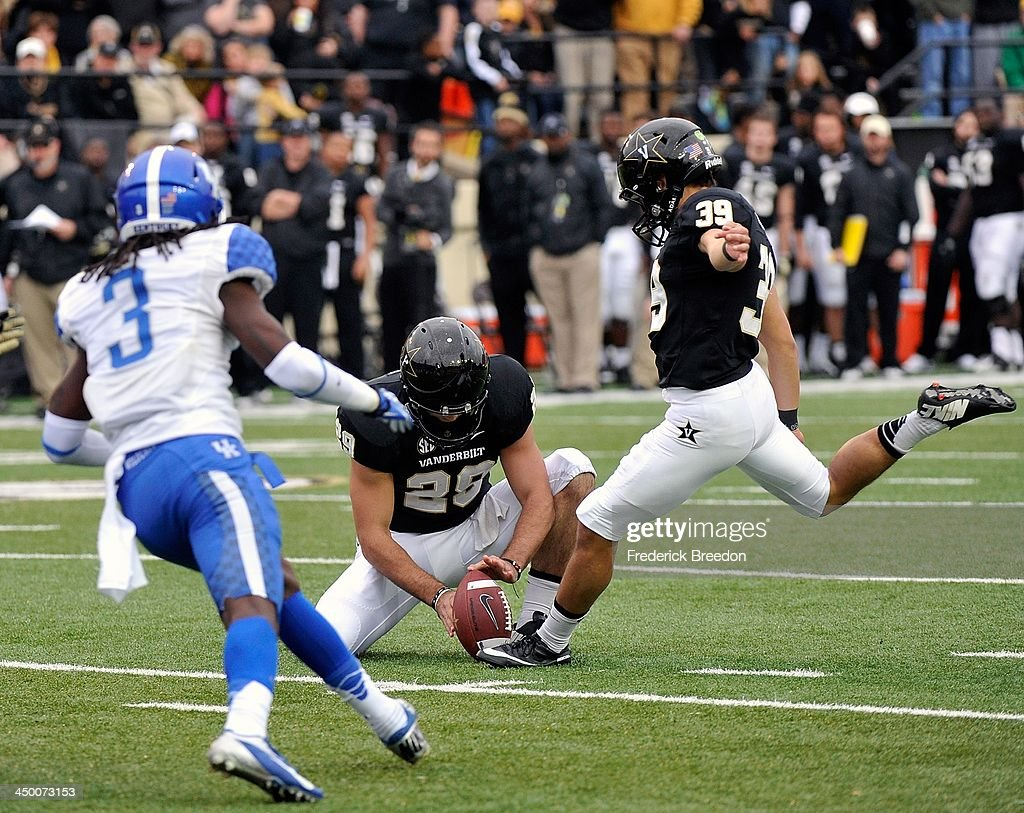 Carey Spear #39 of the Vanderbilt Commodores kicks a field goal against the Kentucky Wildcats at Vanderbilt Stadium on November 16, 2013 in Nashville, Tennessee.