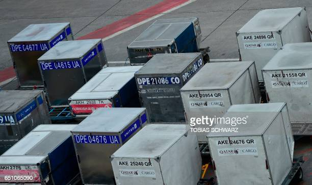Cargo air boxes are placed at the tarmac during a wage strike of ground staff at Berlin's Tegel airport on March 10 2017 / AFP PHOTO / Tobias SCHWARZ