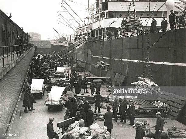 Cargo being loaded or unloaded from a ship Royal Victoria Dock Canning Town London c1930 The dock was built between 1850 and 1855 on an area of...