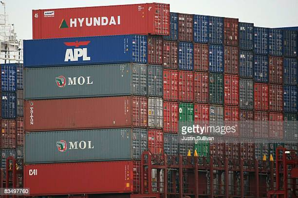 Cargo container are stacked on a ship that is docked at the Port of Oakland October 30 2008 in Oakland California The GDP fell 03% as consumer...