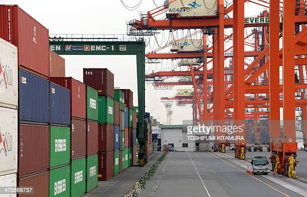 Cargo containers are placed at a container wharf in the port of Tokyo on February 20 2014 Japan's trade deficit swelled in January to another monthly...