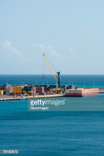 Cargo containers at a commercial dock : Stock Photo
