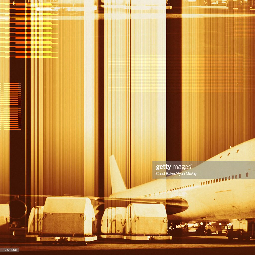Cargo containers being loaded onto plane (digital composite) : Stock Photo