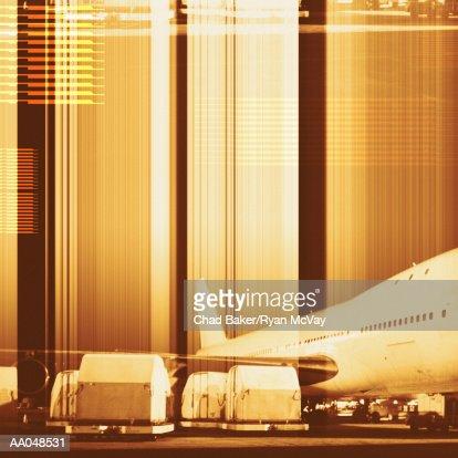 Cargo containers being loaded onto plane (digital composite) : Bildbanksbilder