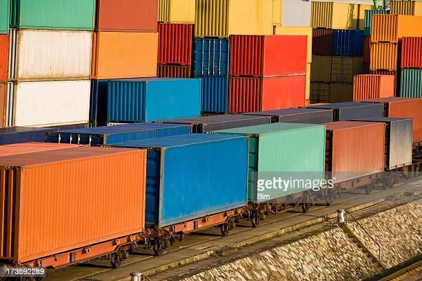 Cargo Containers Stacked at Harbor and Loaded On Train Wagons
