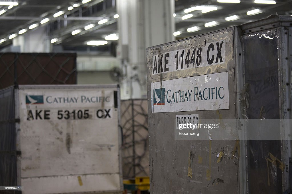 Cargo containers stand in the Cathay Pacific Cargo Terminal in Hong Kong, China, on Monday, Feb. 4, 2013. Cathay Pacific Airways Ltd. aims to replicate its business-class strategy in a cargo trade upgrade. Photographer: Jerome Favre/Bloomberg via Getty Images