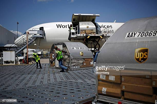 A cargo jet is unloaded during the afternoon sort at the United Parcel Service Inc Worldport facility in Louisville Kentucky US on Tuesday April 21...