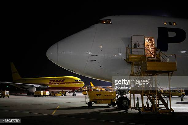Cargo jets sit parked on the tarmac during the overnight sort at the DHL Worldwide Express hub of Cincinnati/Northern Kentucky International Airport...