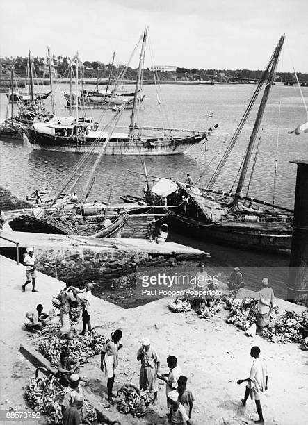 A cargo of bananas from the Seychelles are unloaded from a dhow at Mombasa docks in Kenya circa 1930