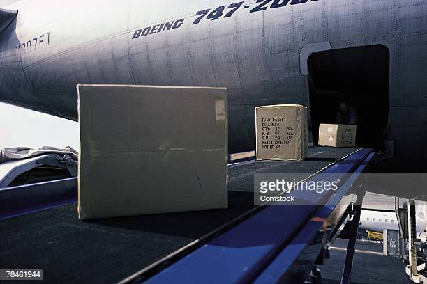 Cargo on conveyer belt outside of airplane