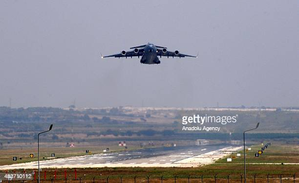 A cargo plane belonging to the United States Air Forces takes off from the runway at the Incirlik Base in Adana Turkey as part of the operations...