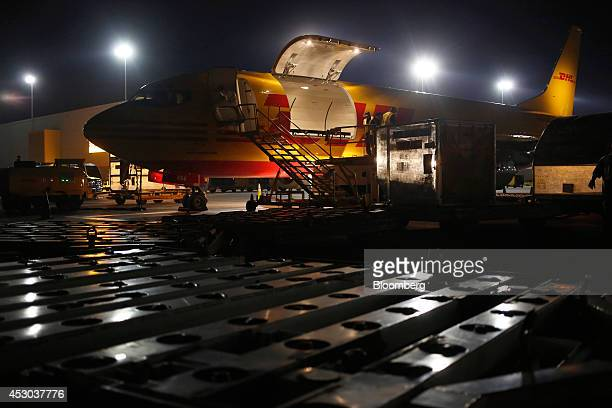A cargo plane is unloaded on the tarmac during the overnight sort at the DHL Worldwide Express hub of Cincinnati/Northern Kentucky International...