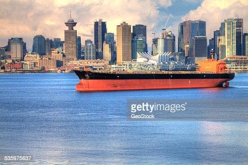 A cargo ship at anchor in a harbor