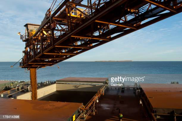 Cargo ship being loaded with crushed ore.