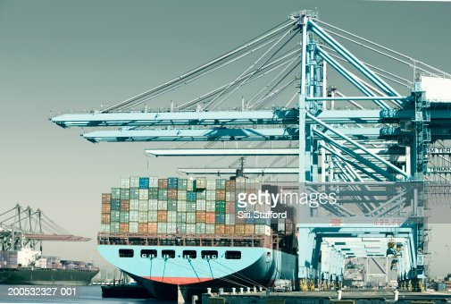Cargo ship loaded with containers at port : Stock Photo