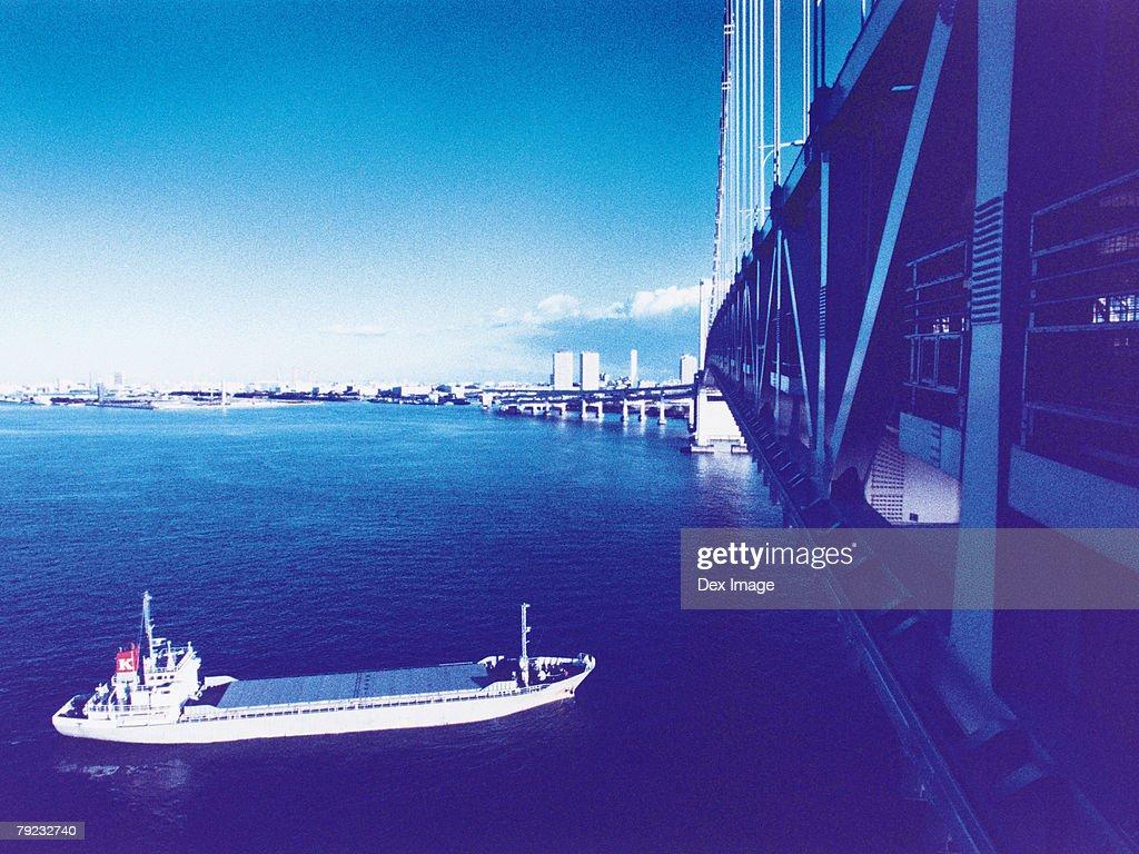Cargo ship moving towards Rainbow Bridge : Stock Photo