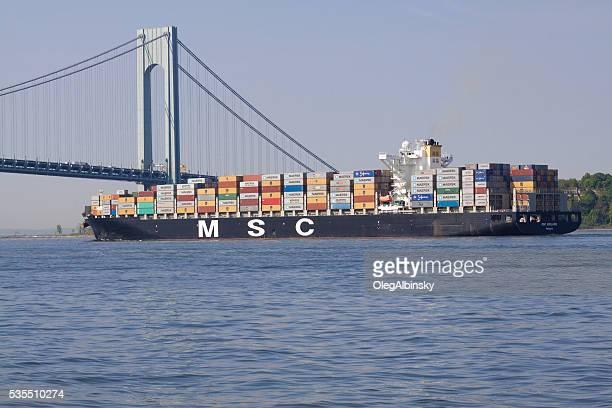MSC Cargo Ship under Verrazano-Narrows Bridge, New York Bay.