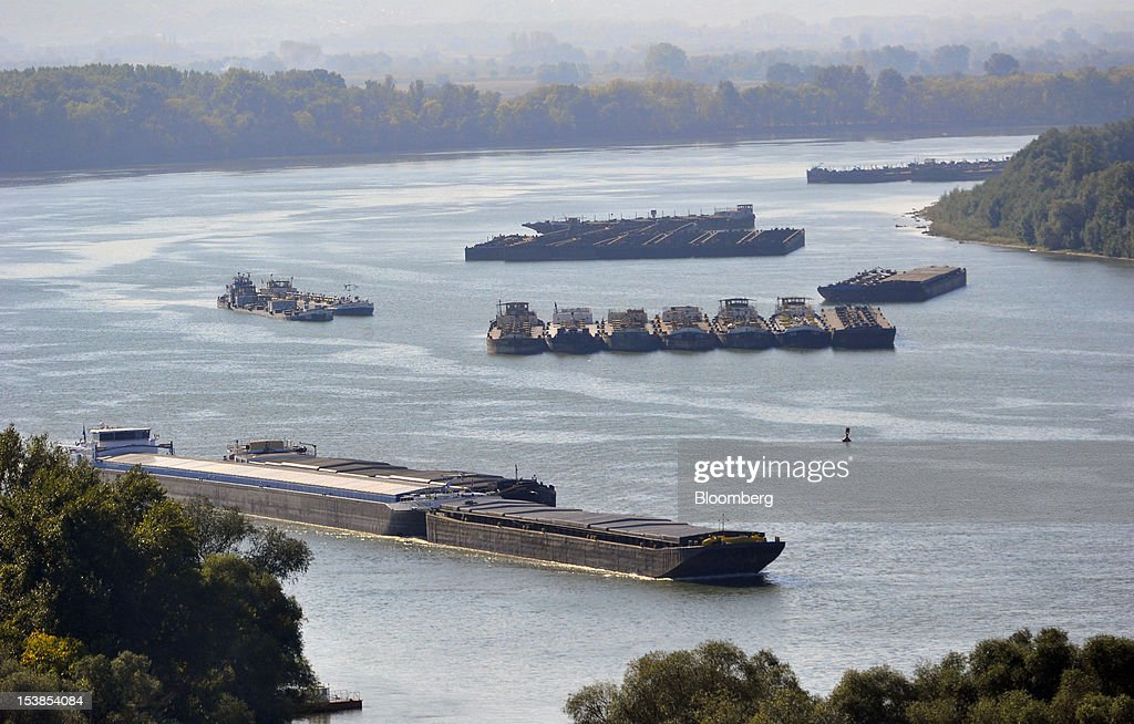 Cargo ships and barges are seen on the Danube river near Pancevo, Serbia, on Tuesday, Oct. 9, 2012. Goods volumes on Europe's longest river after the Volga are 80 percent lower than on the Rhine, the region's busiest waterway, according to EU figures. Photographer: Oliver Bunic/Bloomberg via Getty Images