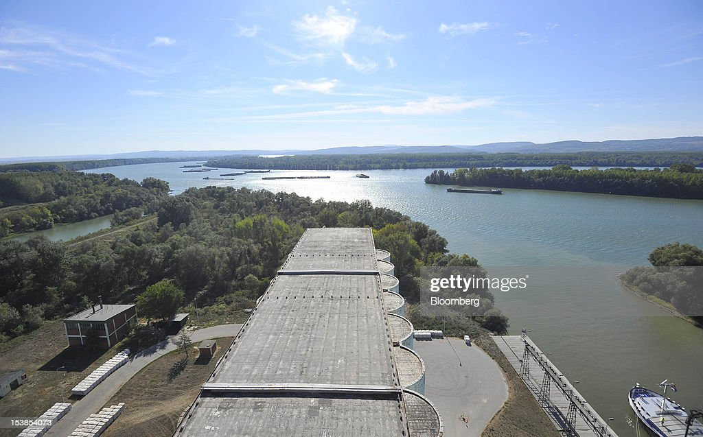 Cargo ships operate on the River Danube seen from the top of grain silos at Granexport AD port, part of MK Group, in Pancevo, Serbia, on Tuesday, Oct. 9, 2012. Goods volumes on Europe's longest river after the Volga are 80 percent lower than on the Rhine, the region's busiest waterway, according to EU figures. Photographer: Oliver Bunic/Bloomberg via Getty Images